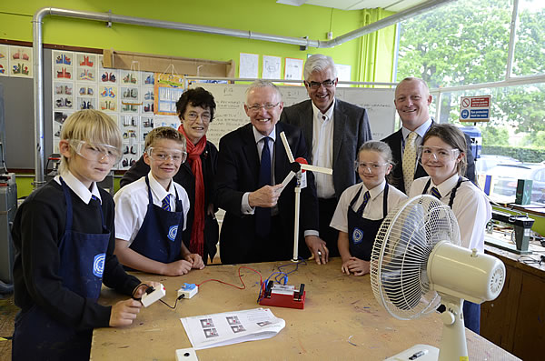 Students from Alderman Peel High School Year 7 give an enthusiastic demonstration of their model wind turbines to Norman Lamb MP, Cllr Marie Strong, Scira's Einar Strømsvåg, and their Headmaster Alastair Ogle.
